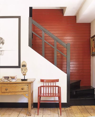 Coral wall / black stairs. Great color combination