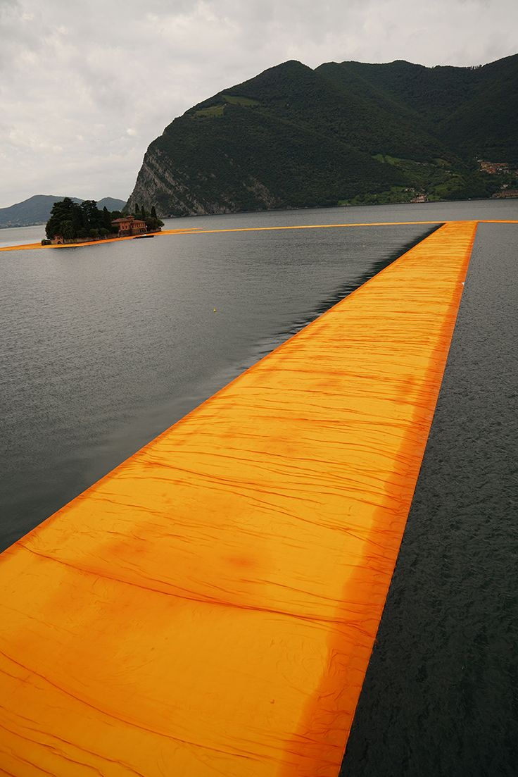 christo's floating piers open to the public in lake iseo, Italy this has got to be one of my favorites done by them because of the way that the public can interact with the project