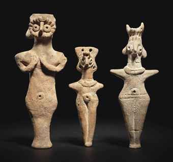 THREE SYRIAN TERRACOTTA IDOLS   CIRCA 2ND MILLENNIUM B.C.