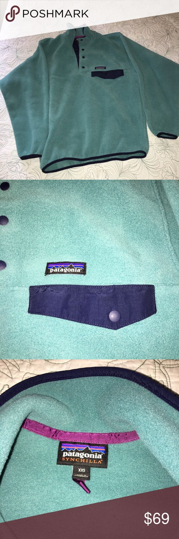 Men's Patagonia XXS synchilla snap t pullover Men's Patagonia XXS synchilla snap t pullover in soft sea green. Fits like a women's XS. Worn only once. Also washed once. No rips, stains or odors. Navy accents/piping. Comes from a smoke-free, pet-free home. Patagonia Tops