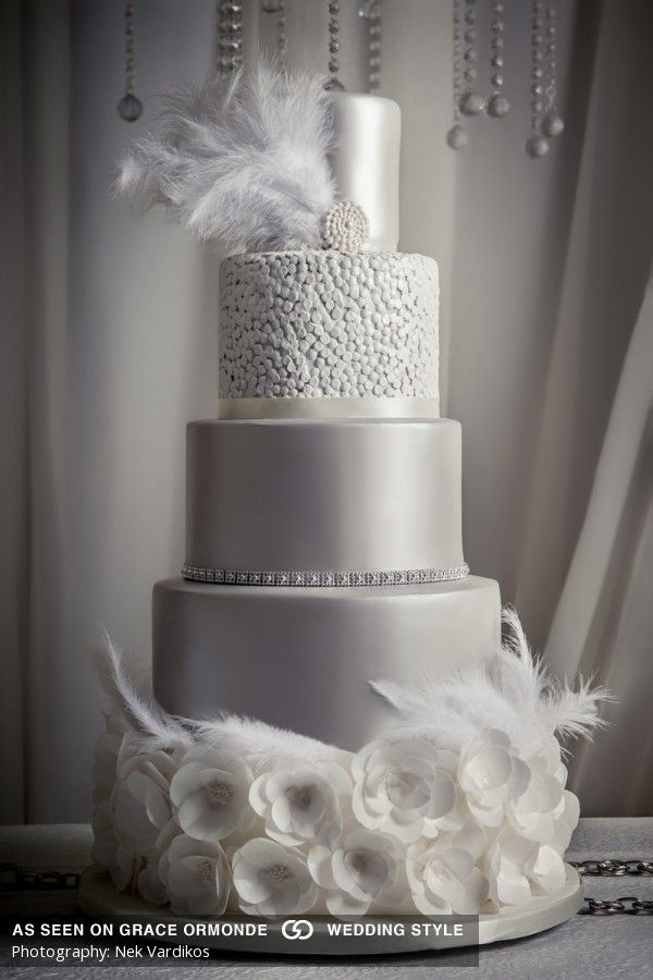 silver cake inspired by clouds features feathers anad blossom