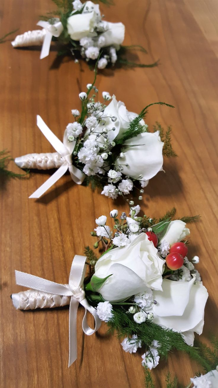 Elegant, fall colours in a boutonniere for the groom.  white spray roses, baby's breath, hypericum berries, fern...
