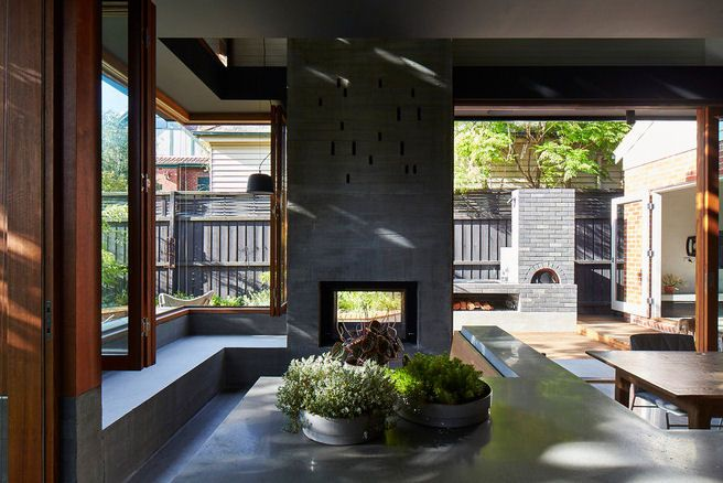 concrete fireplace with built in bench