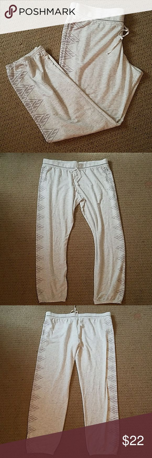 NWOT Victoria's Secret Sweatpants Light grey VS sweatpants with design going up the side of each leg. Never worn except to try on! VERY comfortable and VERY soft! Victoria's Secret Pants Track Pants & Joggers