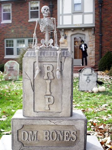Create a decrepit tombstone using foam slabs, a rotary carving tool, and stone-look spray paint.