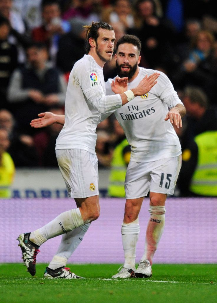 Gareth Bale of Real Madrid celebrates with team mate Daniel Carvajal as he scores their fourth goaland completes his hat trick during the La Liga match between Real Madrid CF and RC Deportivo La Coruna at Estadio Santiago Bernabeu on January 9, 2016 in Madrid, Spain. (Jan. 8, 2016 - Source: Denis Doyle/Getty Images Europe)