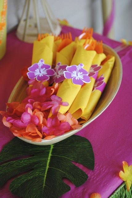 Luau napkins - Like in the restaurants, but with colored tissue paper and flowers/ribbon.