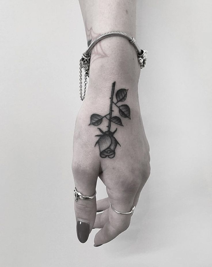 Rose Hand Tattoo http://tattooideas247.com/rose-hand/