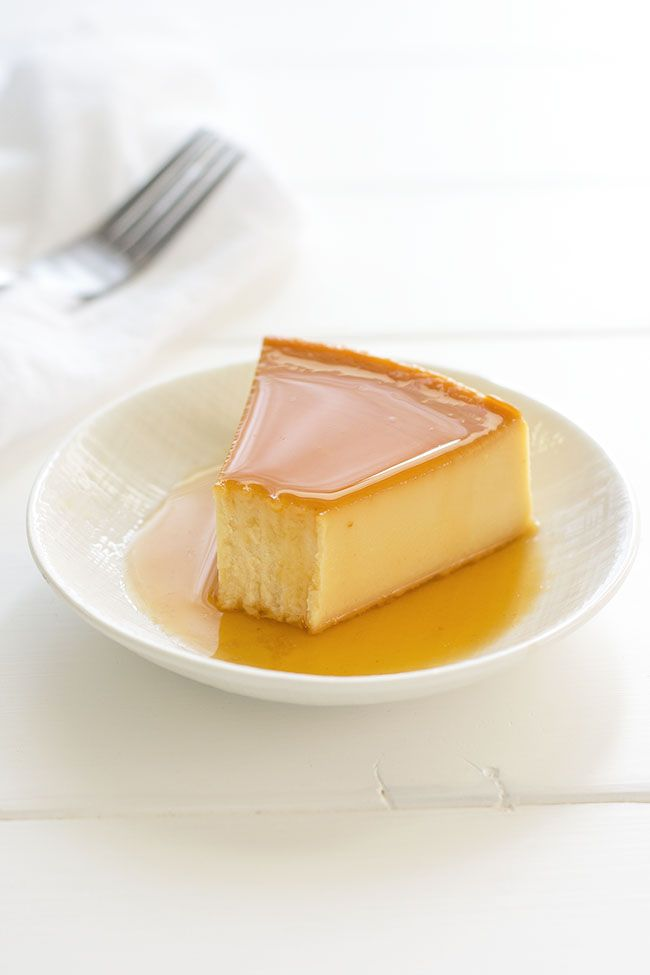 Puerto Rican Flan de Queso: cheesecake-like baked custard dessert with sugar caramel sauce! Not too sweet thanks to the tang of cream cheese!