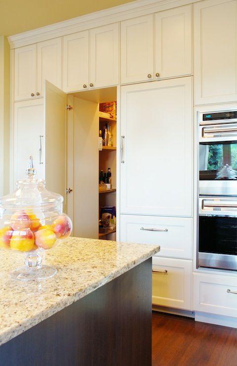 Hidden pantry behind cabinet doors doubles as a secret for Hidden pantry