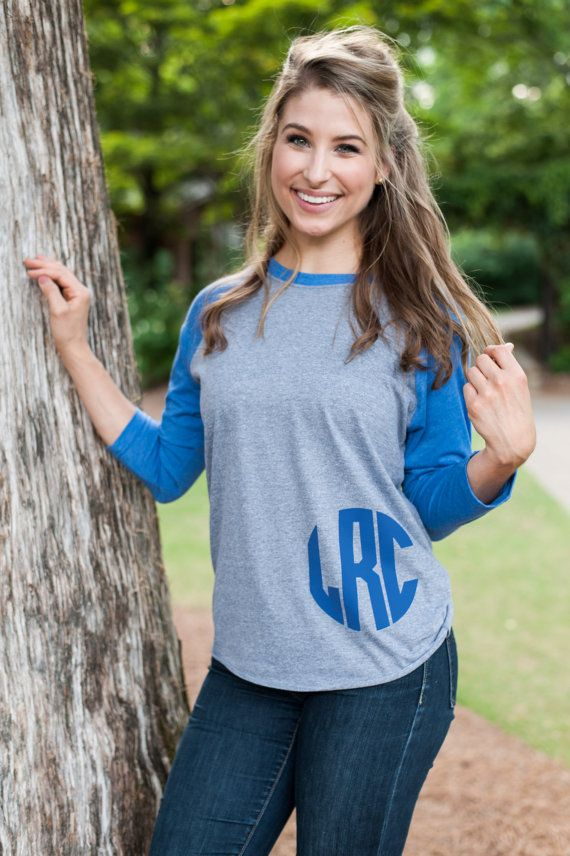 Monogrammed Shirt, Monogrammed Raglan, Monogrammed Baseball Shirt, Personalized Shirt, Personalized Raglan, Monogram Shirt, Personalize Raglan Baseball Jersey T-Shirt. Your choice of colors and vinyl colors. Dress it up with jewelry or dress it down with jeans and sandles. Model is wearing an American Apparel Raglan Baseball Shirt. If the color you pick is out of stock a comparable brand will be substituted in its place without notice. Font: Circle Interlinking  Colors Available: Black…