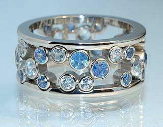 Janet's ring  18k White gold, Ceylon Sapphires, White Sapphires.. Eva Martin Jewelry