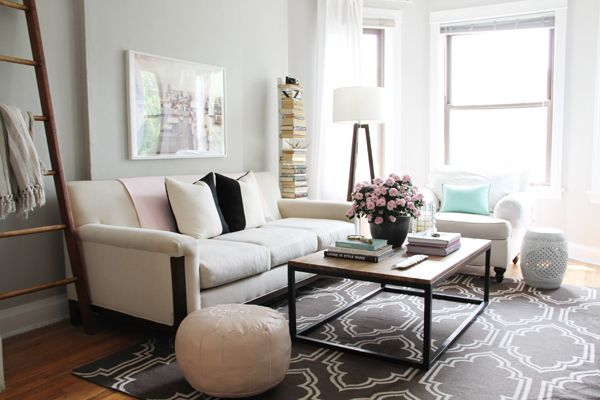 Editor @Alaina Marie Kaczmarski's Home Tour // pink and grey living room // @Elise West elm rug and tripod lamp // @StoneTextile colorblock pillows // @Jay Hart Home coffee table // pink pouf