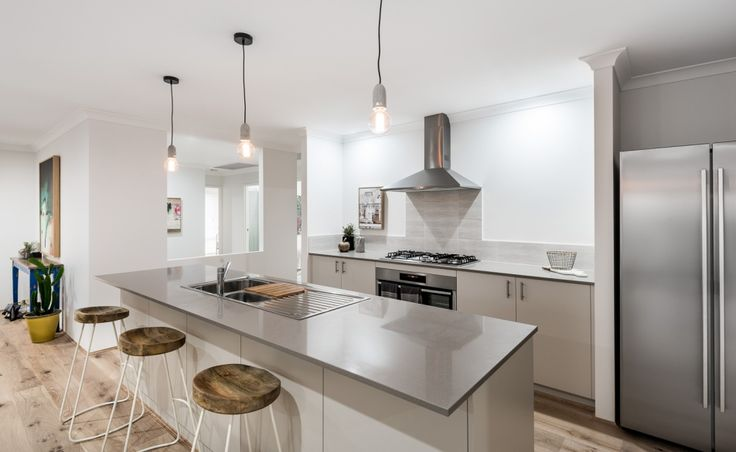 Galley kitchen with 900mm Westinghouse appliances, Caesarstone benchtops and walk-in pantry