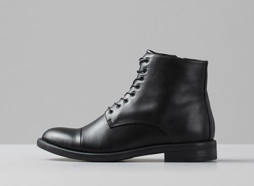 Vagabond - AMINA. This is a part of our Non-animal collection. This black Amina lace-up boot is part of our non-animal segment, meaning that it is 100% vegan friendly. The upper is made from quality synthetic PU and has a cork insole. Take care of your shoes by cleaning them with a damp textile cloth. They don't need any other protection which helps to save the environment. SEE ALL AMINA