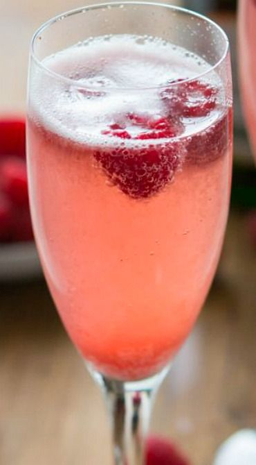 Champagne Punch Bellini ~ 1 bottle champagne, sparkling wine, or prosecco ~ 1/2 cup raspberry sorbet (or your favorite flavor sorbet) ~Fresh raspberries (or your favorite fruit) ~ For each serving: place 1 tablespoon of sorbet in the bottom of a champagne flute. Fill with champagne and top with a fresh berry. Serve immediately.