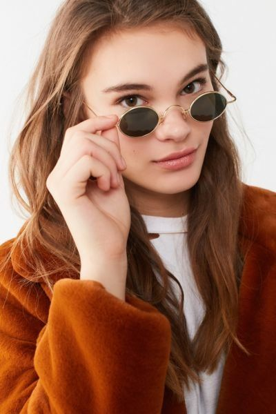 0b669e17aa Shop Vintage Mini Oval Sunglasses at Urban Outfitters today. We carry all  the latest styles