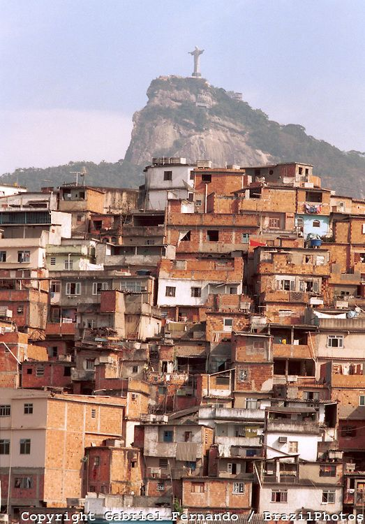 Morro da Coroa ( Coroa slum ) at Santa Teresa quarter, Rio de Janeiro favela, Brazil. Christ the Redeemer and Corcovado in the background.