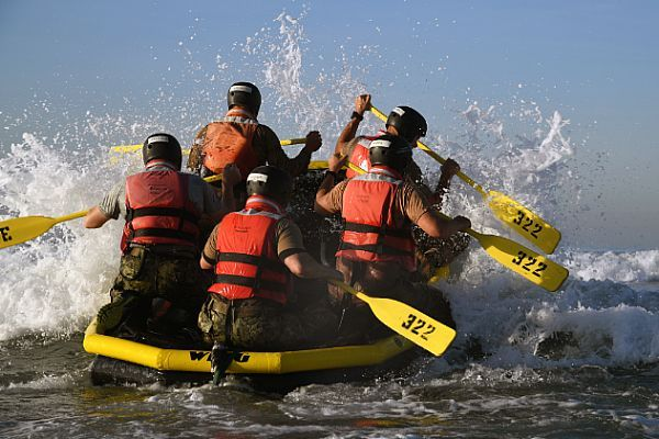 Senior officers and enlisted personnel assigned to Naval Special Warfare Command paddle into the surf at Naval Amphibious Base Coronado during Surf Passage. Surf Passage is a series of evolutions that are a part of the first phase of SEAL training. Navy SEALs are the maritime component of U.S. Special Forces and are trained to conduct a variety of operations from the sea, air and land.  U.S. Navy photo by Petty Officer 2nd Class Timothy M. Black (Released)  161108-N-AV746-207