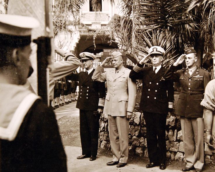 80-G-87340: Left to right:  Admiral Sir Andrew B. Cunningham, RN; General Dwight D. Eisenhower, USA; Admiral H.K. Hewitt, USN, and General W.B. Smith, USA, at ceremonies for Admiral Sir Cunningham who relinquished his duties as CINC Med to assume role of First Sea Lord of the Admiralty.  Photograph released October 16, 1943.   U.S. Navy photograph, now in the collections of the National Archives.  (2017/04/04).