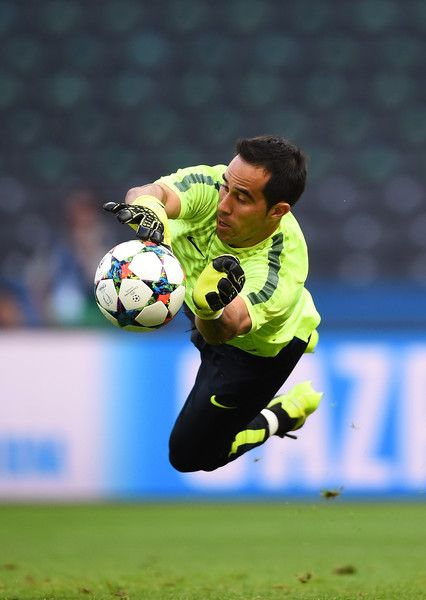 Claudio Bravo of Barcelona makes a save during an FC Barcelona training session…