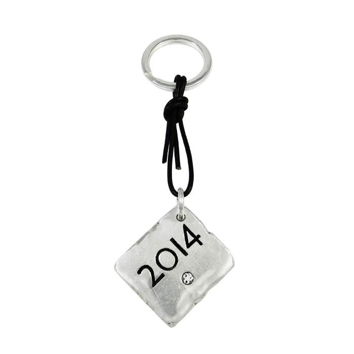 From the letters of the Greek alphabeticscript, we created a unique lucky charm, as a key-ring and we engraved on the reverse the year 2014. Silver-plated bronze attached with black leather on the ring.