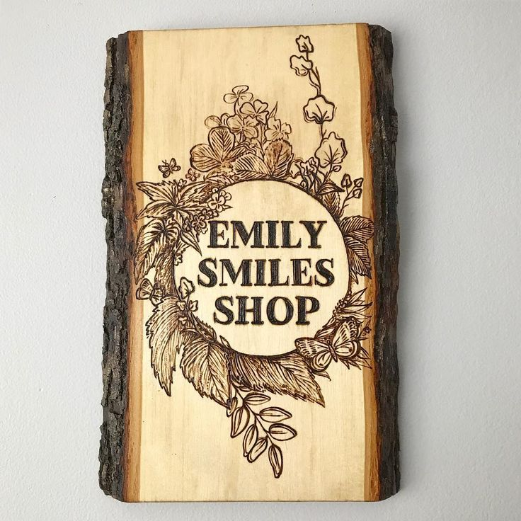 Emily smiles shop, wood burned sign