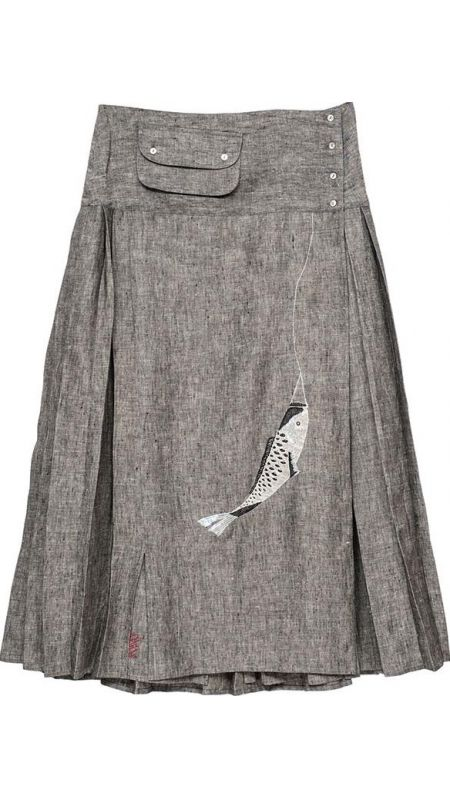 Pleated overlap linen skirt. Waistband lining in printed cotton voile and adjustable buttons.  Little pocket with flap in waistband.  Embroidered front panel.  Mother of pearl buttons. No lining. One size. 100% Linen
