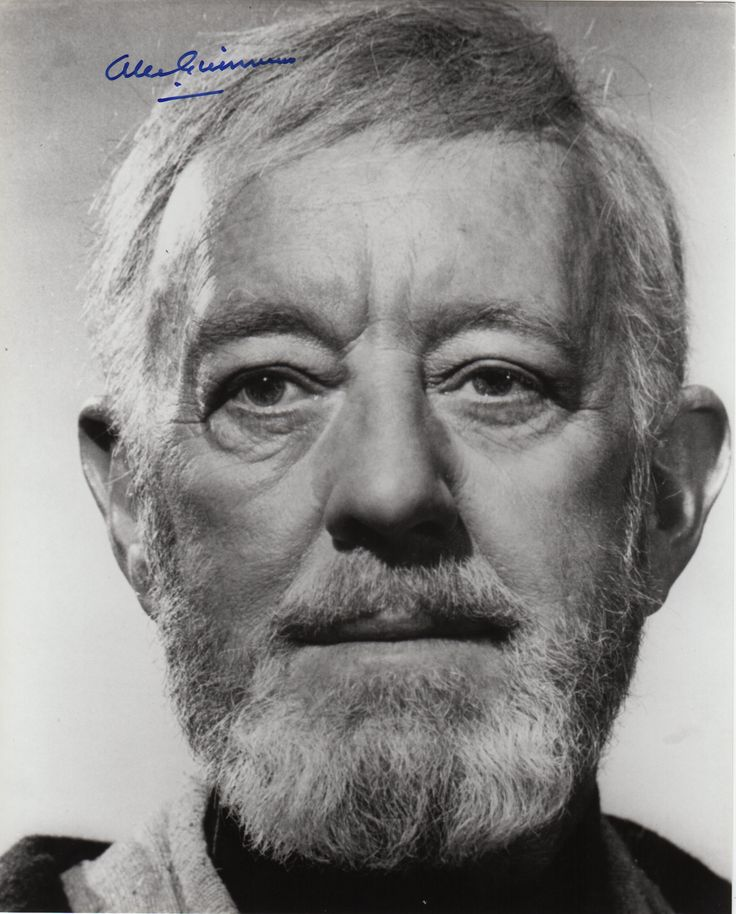 GUINNESS ALEC: (1914-2000) English Actor, Academy Award winner. Signed 8 x 10 photograph of Guinness in a close-up portrait in costume as Obi-Wan Kenobi from Star Wars (1977). Signed in bold blue ink with his name alone across a clear area at the head of the image.