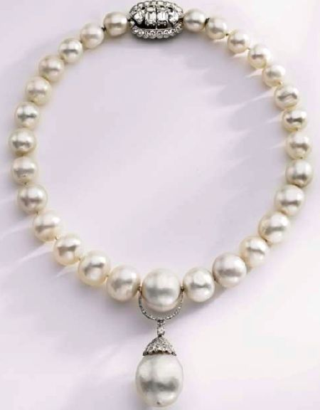 Duchess of Windsor's (originally belonging to Queen Mary) natural pearl and diamond necklace by Cartier, purchased at auction by Calvin Klein for former wife, Kelly.