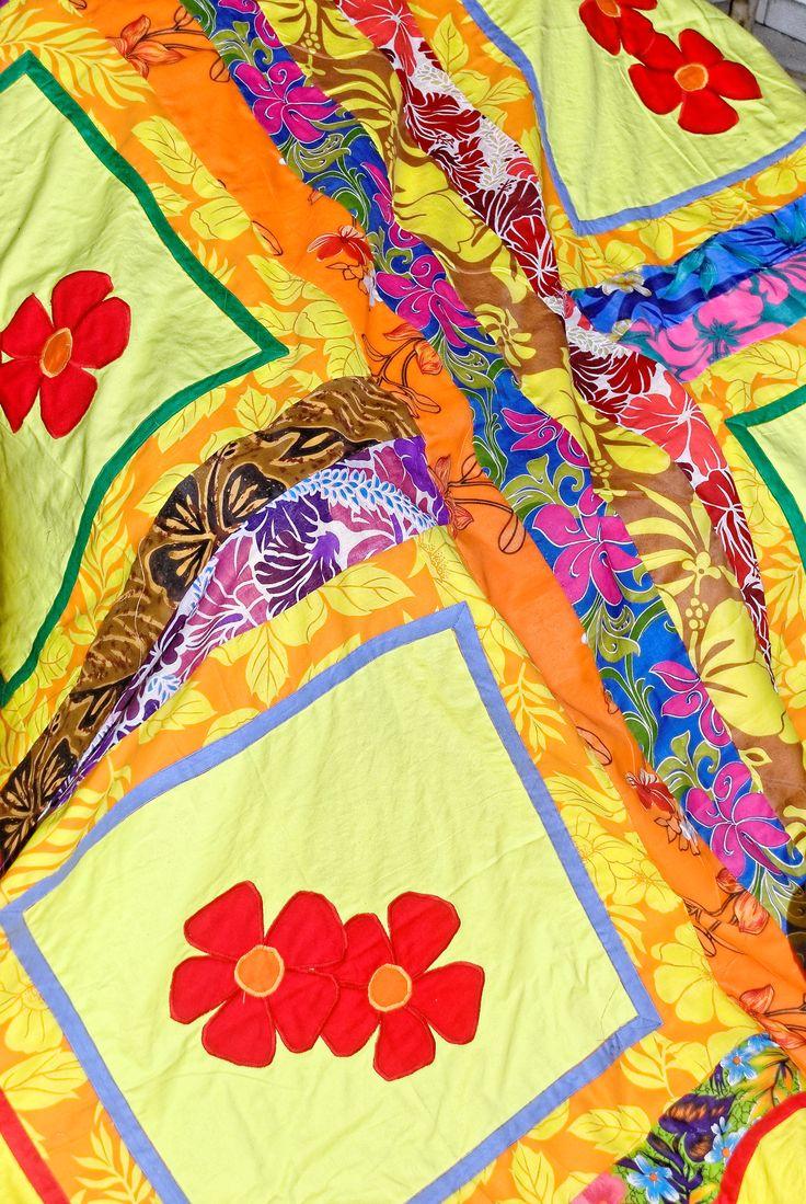 Appliques de fleurs et patchwork sur drap jaune