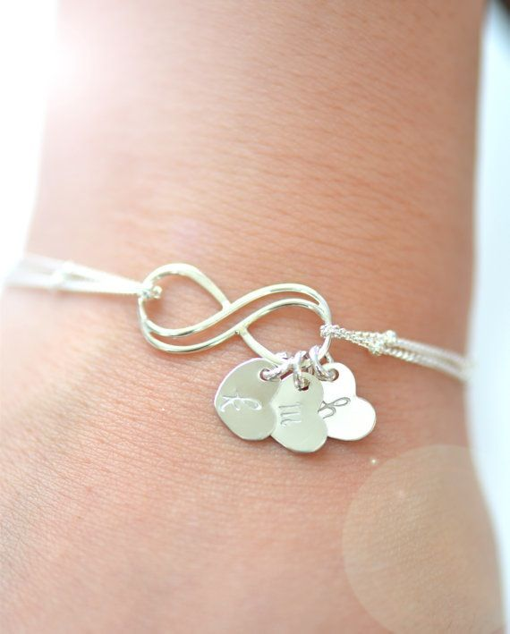 Personalized Infinity Bracelet Simple and ElegantA delicate dainty everyday bracelet.**A sterling silver infinity charm (20mm)**Double sterling silver satellite cable chain** **8.5mm dainty hearts, Hand stamped with the initial of your choice. Letters can be darkened or not darkened(picture shows not darkened).**Initials will not be darkened unless it is stated in the notes section during checkout.***Please look at picture 5 for font choices. If no font is ...