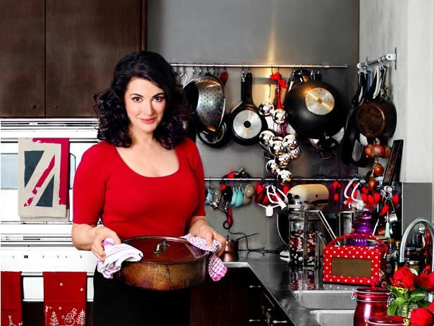 Nigella Lawson's Kitchen : British celeb chef Nigella Lawson has made a career of helping stressed-out home cooks, and she can certainly relate: She writes her cookbooks in her own hectic family kitchen, which she shares with her husband, advertising executive and art dealer Charles Saatchi, and children, Mimi, Phoebe and Bruno.