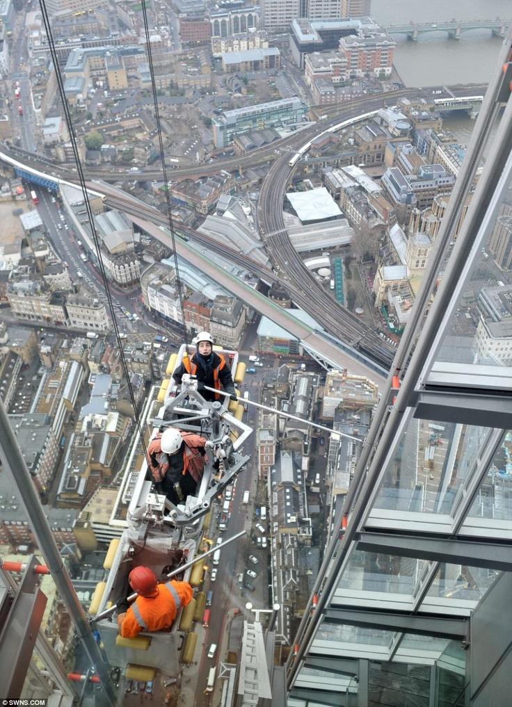Workers ascending The Shard London as seen from Level 72, the open-air viewing gallery