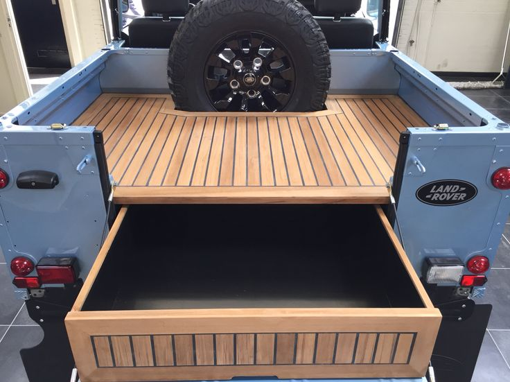 Tophat restored Defender 90 with bikini top and teak wooden rear deck