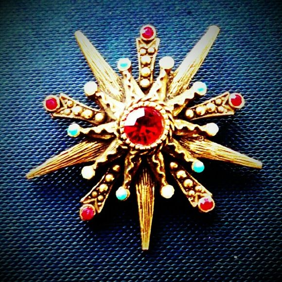 """Vtg Florenza Garnet & Turquoise Starburst Brooch Vintage Florenza Garnet & Turquoise Starburst Brooch. Gorgeous glass faceted cabachons in garnet, and rounded turquoise cabachons encompass this pearl and Rhinestone encrusted beauty. Measures approximately 2"""".  A beautiful unsigned piece by Florenza in perfect condition. Vintage Havana Jewelry Brooches"""