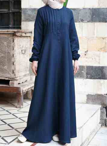 Abaya with Tucks Blue Nights color Linen lovers, this one's for you: one of our most popular abayas is now available again in our soft and lightweight linen. This abaya is so supple and serene you won't want to take off, and the fine linen fabric makes all-day-long wear possible. Modesty was never so easy.   Price: $124.95 $109.95