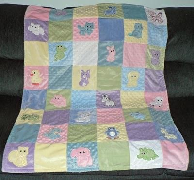 Cute Quilt for Baby. Machine appliqued on Minkie Fabrics. Soft and Cuddly!