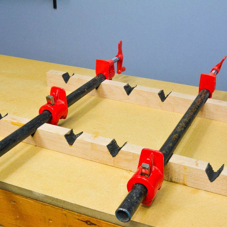 Keep your bar clamps from falling over when you're using them by building a clamp stand and adding some anti-skid material to the v grooves. #woodworking #DIY