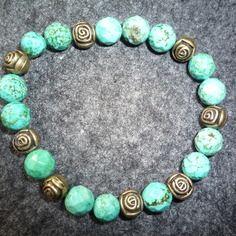 N°2 - bracelet élastiqué perles rondes à facettes turquoise naturelle et 8 roses bronze antique