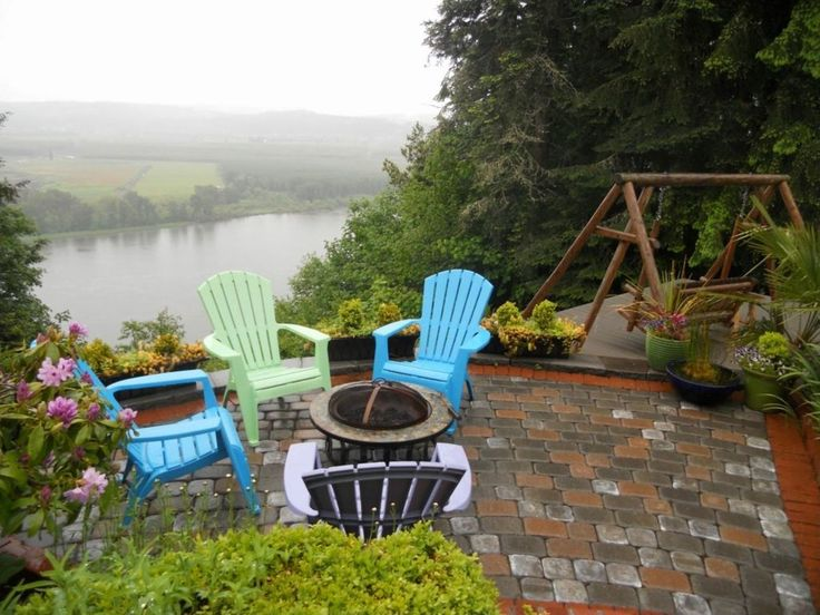 Cottage Patio with Red Ember Rubbed Bronze Crossweave 36 inch Wood Burning Fire Pit, Adams Resin Stacking Adirondack Chair