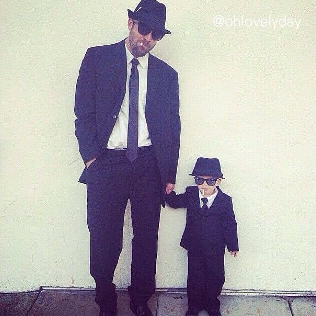 Need a great father/son Halloween costume idea? How about the Blues Brothers! My husband already had everything he needed in his closet and we found Charlie's outfit super easy. Cigarettes are rolled up paper or you could do a lollipop) so relax (I don't condone toddler smoking but it really did make the outfit).