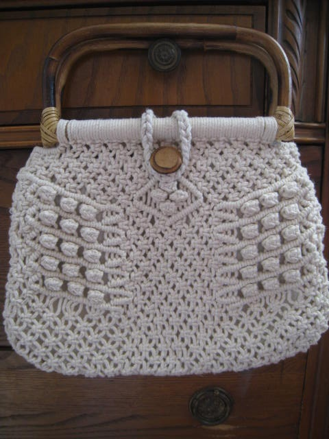Macrame purse with a wooden or bamboo handle. I remember having one.