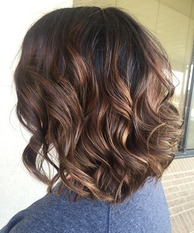 Caramel babylights on dark brown hair.