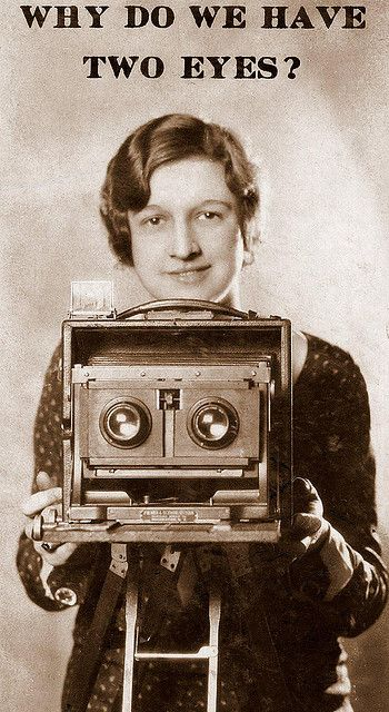 'Pretty Girl with an Old Stereo Camera.' ca.1920s. Unknown photographer. S)