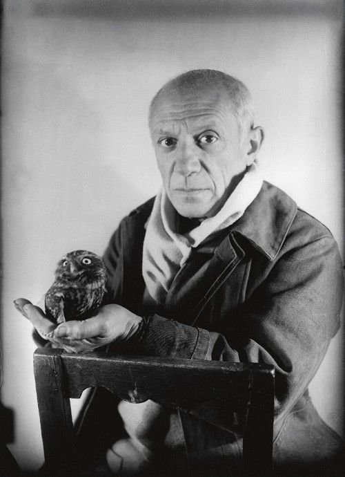 """Picasso with Owl. """"God is really only another artist. He invented the giraffe, the elephant and the cat. He has no real style, He just goes on trying other things."""""""