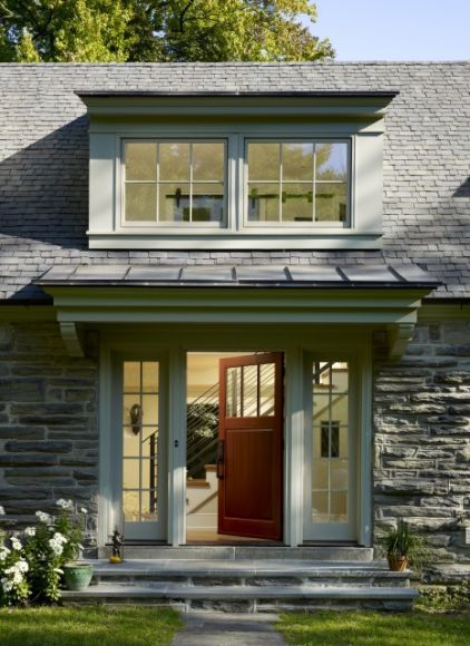 A shed dormer has the power to add visual height to your home. Centered above the entrance, large shed dormer windows draw the eye upward on this Philadelphia home.