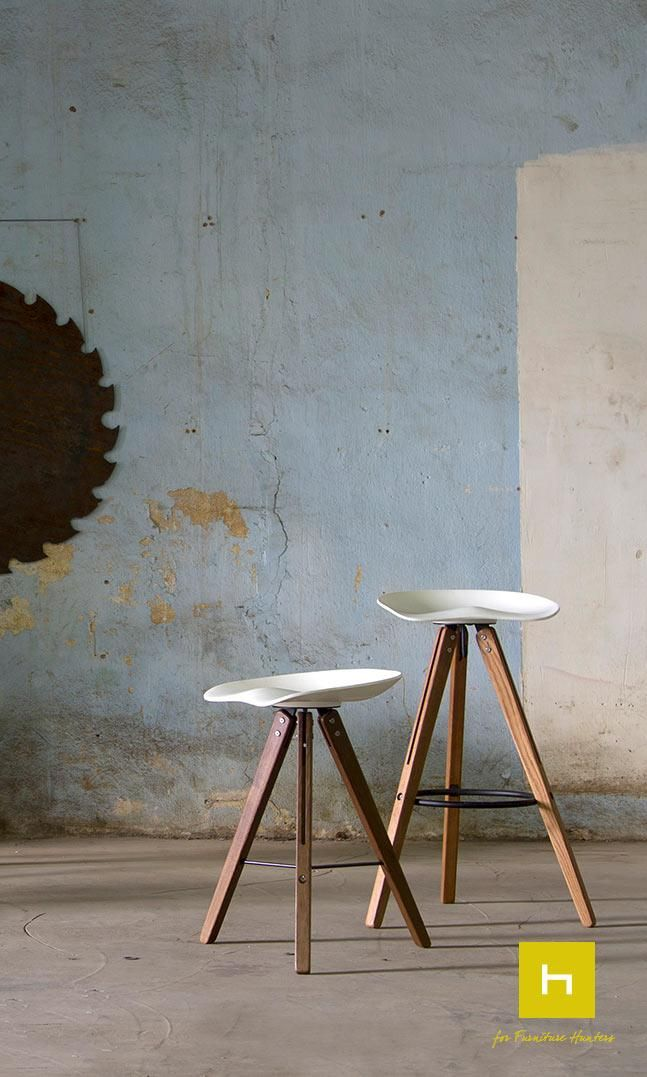 The Theo Tractor bar stool with a solid surface seat shell. The shell design is inspired by the industrial tractor seat of the early 20th century. Featuring the signature solid white oak Theo legs. #furniturehunters #industrialdesign #furnituredesign