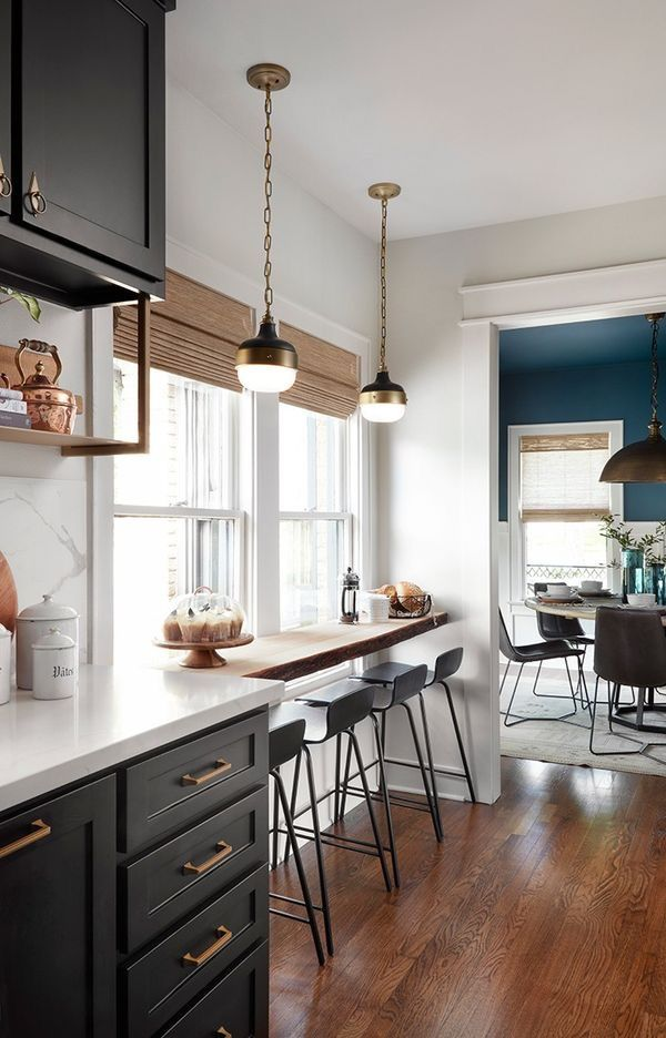 black and white kitchen with pops of color and natural shades
