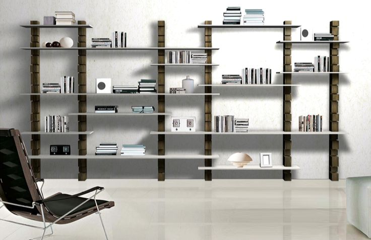 Shark wall-unit in the living room, with shelves of different lengths.
